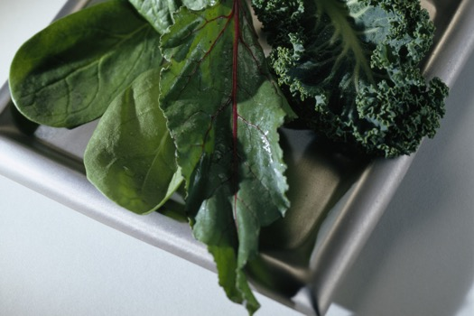 Plate of kale, beets and spinach, close-up
